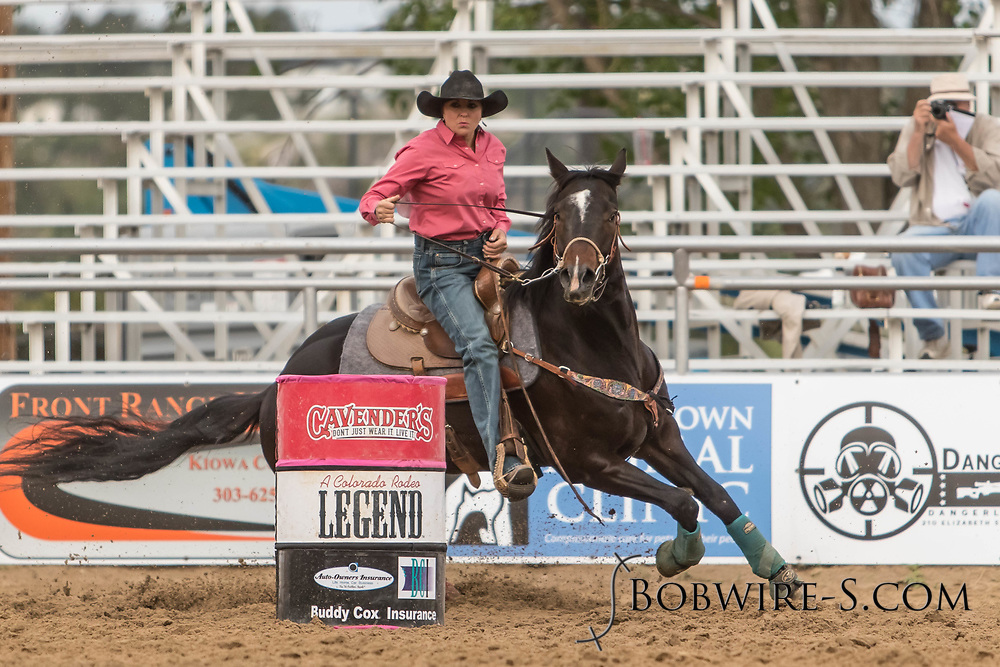 Heather Milligan makes her barrel racing run during slack at the Elizabeth Stampede on Sunday, June 3, 2018.