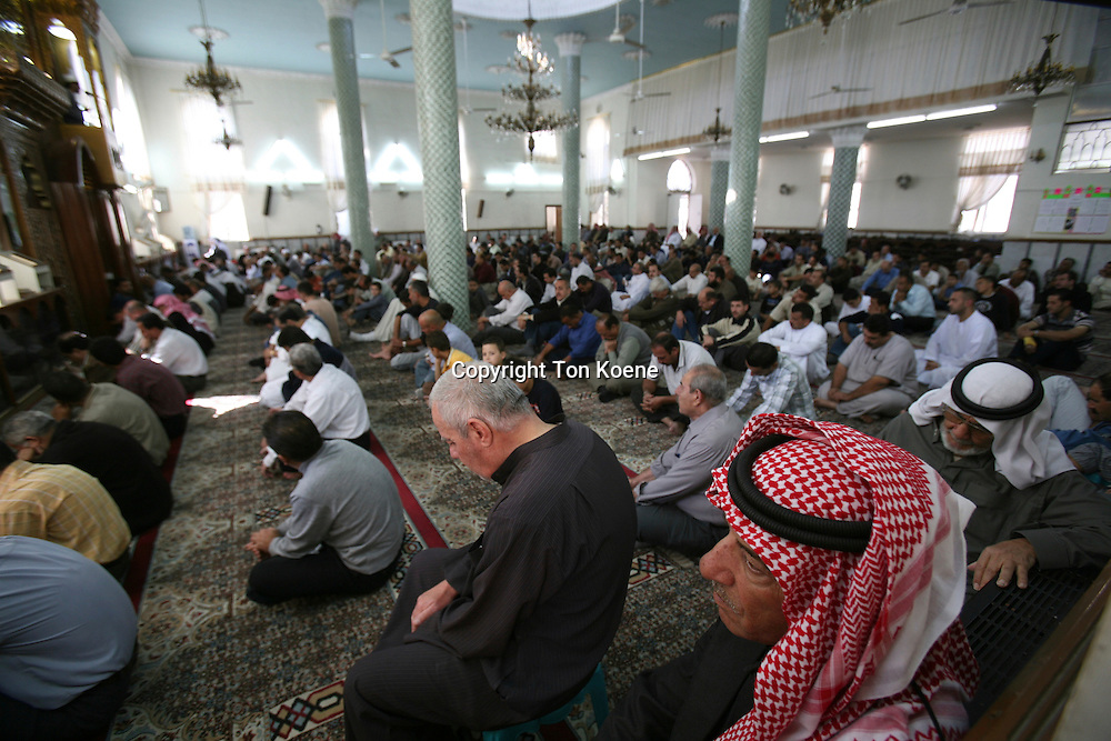 muslims pray in a mosque in Amman, Jordan