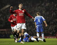 Photo: Paul Thomas.<br /> Manchester United v Wigan Athletic. The Barclays Premiership. 26/12/2006.<br /> <br /> Ole Gunnar Solskjaer celebrates (L) his goal for Man Utd.