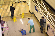 A prisoner on cleaning duties. HMP Wandsworth, London, United Kingdom
