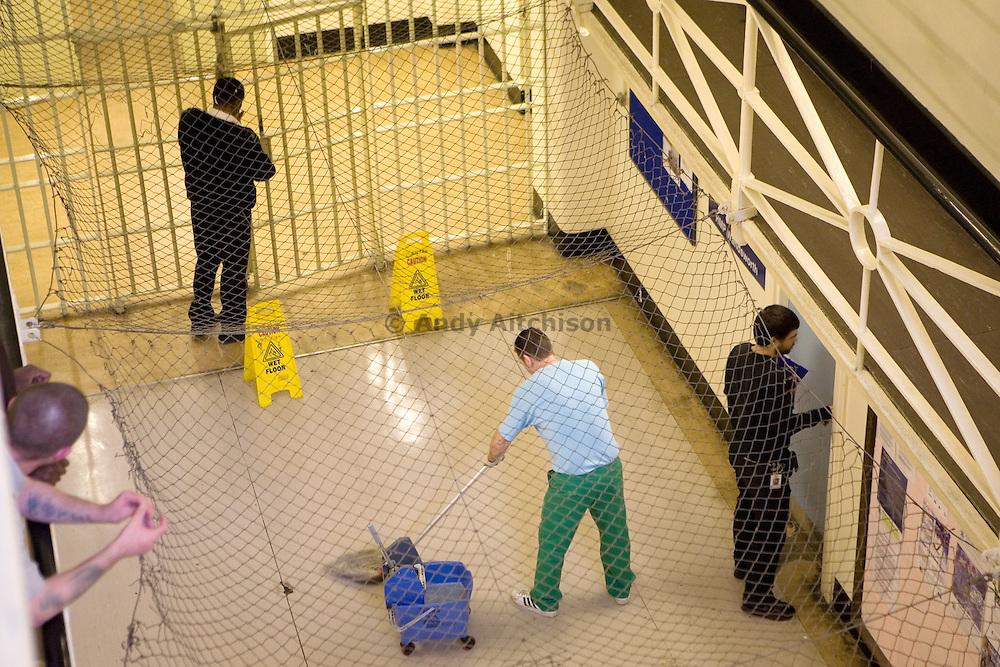 A prisoner on cleaning duties. HMP Wandsworth, London, United Kingdom