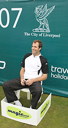 Liverpool, England - Tuesday, June 12, 2007: Greg Rusedski sits in the line-judge's chair on day one of the Liverpool International Tennis Tournament at Calderstones Park. For more information visit www.liverpooltennis.co.uk. (Pic by David Rawcliffe/Propaganda)
