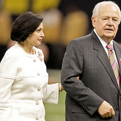 2009 October 04: New Orleans Saints owner Tom Benson with his wife on the field prior to kickoff of a 24-10 win by the New Orleans Saints over the New York Jets at the Louisiana Superdome in New Orleans, Louisiana.