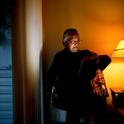 "Richard Williams, who is 58 and disabled, reads the Bible in his apartment at the Hillcrest View Apartments in Boise, Idaho. Williams has a spinal injury that makes him fatigued after walking for 20 or 30 minutes. He lives on social security and housing vouchers. His apartment complex, Hillcrest View Apartments, decided it will no longer accept housing vouchers, forcing him to move out. He's optimistic he'll find another apartment that takes vouchers, but there's a lot of competition for those, especially since several large property managers are no longer accepting vouchers. Williams, who said he prays often, is hopeful that he will have an apartment before his move out deadline. ""(God) will come through always. Without the Lord, I would be doomed.  With Him, I have the best life. It is a gift"". Monday October 26, 2015"