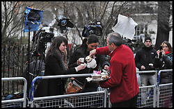 Neighbours of the late Baroness Thatcher bring tea out for the media  outside Baroness Thatcher's house in Chester Square, London, UK, after her death today,Monday 8 April, 2013. Photo By Andrew Parsons / i-lmages.