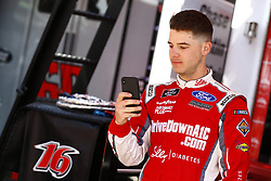 April 13, 2018 - Bristol, Tennessee, United States of America - April 13, 2018 - Bristol, Tennessee, USA: Ryan Reed (16) takes a photo of his Roush Fenway Racing Ford before opening practice for the Fitzgerald Glider Kits 300 at Bristol Motor Speedway in Bristol, Tennessee. (Credit Image: © Chris Owens Asp Inc/ASP via ZUMA Wire)