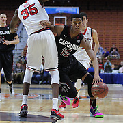 PJ Dozier, South Carolina, drives to the basket past Yankuba Sima, St. John's, during the St. John's vs South Carolina Men's College Basketball game in the Hall of Fame Shootout Tournament at Mohegan Sun Arena, Uncasville, Connecticut, USA. 22nd December 2015. Photo Tim Clayton