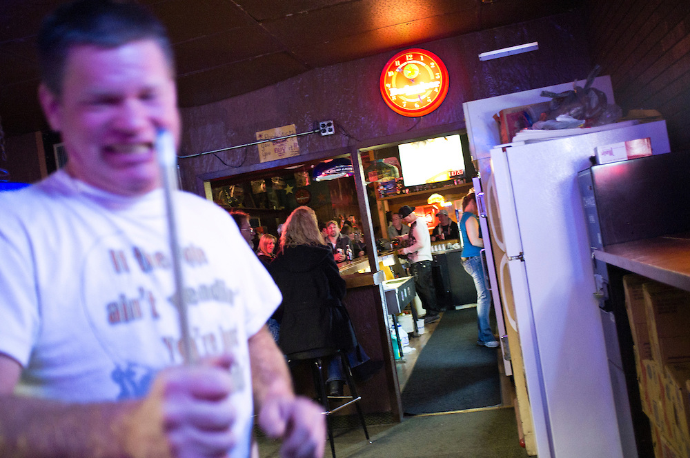 Steve McFarland holds a pool cue at a bar on Friday, December 2, 2011 in Webster City, IA.
