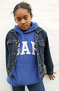 Portrait of young black girl with Gap hoodie and jean jacket, London, 2000's