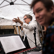 """June 21, 2014 - New York, NY : <br /> The city was flooded with music on Saturday as Make Music New York brought more than 1,300 free concerts to the city's streets and parks. The annual festival's program included the performance """"'In (Key)' - New Compositions in Celebration of Terry Riley's 'In C' @ 50 Years"""" on Cornelia Street, in front of the Cornelia Street Cafe in Greenwich Village, on Saturday afternoon. Pictured here, Jed Distler, who helped organize the performance, center, addresses the audience during a break in play. At foreground right is musician and composer Patrick Grant.<br /> CREDIT: Karsten Moran for The New York Times"""