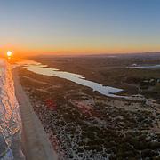 Aerial panoramic sunset seascape of famous Montegordo beach, Algarve. Portugal.