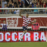United States Midfielder Jermaine Jones (13) celebrates during an international friendly soccer match between Scotland and the United States at EverBank Field on Saturday, May 26, 2012 in Jacksonville, Florida.  The United States won the match 5-1 in front of 44,000 fans. (AP Photo/Alex Menendez)