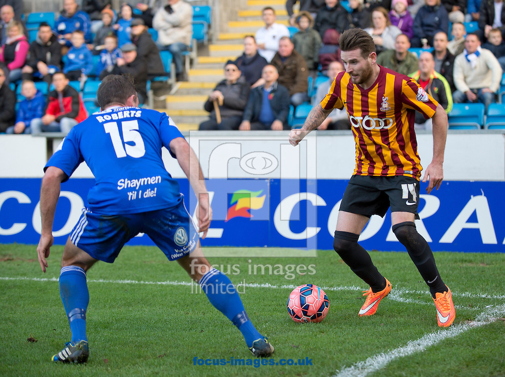 Mark Yeates of Bradford City looks to find his way past Kevin Roberts of FC Halifax Town during the The FA Cup match at Shay Stadium, Halifax<br /> Picture by Russell Hart/Focus Images Ltd 07791 688 420<br /> 09/11/2014