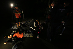 © London News Pictures. Migrants are seen on the ground close to a stand off with police at the Hungarian and Serbian border town of Roszke, Hungary, September 8 2015. The UN's humanitarian agencies are on the verge of bankruptcy and unable to meet the basic needs of millions of people because of the size of the refugee crisis in the Middle East, Africa and Europe, senior figures within the UN have told the media.   Picture by Paul Hackett /LNP