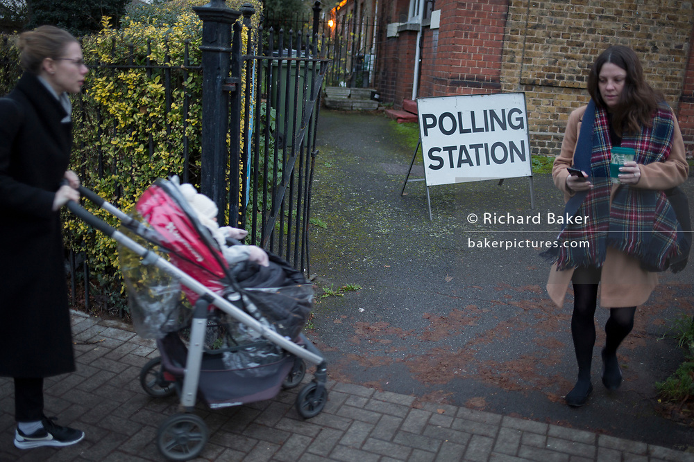 Voting arrive at the church of St. Saviour's in the south London borough of Lambeth, serving as a polling station for the UK's General Election 2 weeks before Christmas, on 12th December 2019, in London, England.
