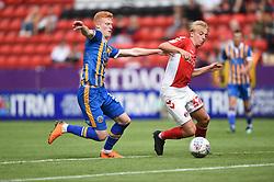 Charlton Athletic's George Lapslie gets away from Shrewsbury Town's Ryan Hanes