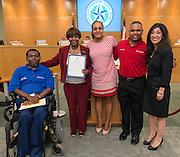 Houston ISD trustees Rhonda Skillern-Jones and Juliet Stipeche pose for a photograph with Barbara Jordan Endeavors founder Thelma Scott and BJE ambassadors, September 12, 2013.