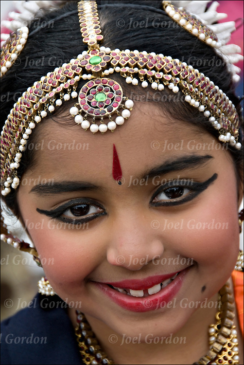 Portrait of young East Indian American classical Bharatnatyam dancer at the 21st Annual Diwali (Deepavali) Festival at the South Street Seaport in New York City.The Festival of Lights originated in India to celebrate the joy of living. The triumph of good over evil and light over darkness.