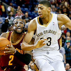 Nov 22, 2013; New Orleans, LA, USA; Cleveland Cavaliers point guard Kyrie Irving (2) drives past New Orleans Pelicans power forward Anthony Davis (23) during the fourth quarter of a game at New Orleans Arena. The Pelicans defeated the Cavaliers 104-100. Mandatory Credit: Derick E. Hingle-USA TODAY Sports