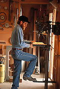 Bob Goodman, a rancher in Halfway, Oregon, lost his arm in a freak accident. Researchers at the University of Utah gave him a myoelectric arm, which he controls by flexing the muscles in his arm that are still intact. Sensors on the inside of the prosthetic arm socket pick up the faint electrical signals from the muscles and amplify them to control the robot arm. In this way, Goodman can do most things as he did before his accident. Here he is using a drill press in the workshop in his barn.