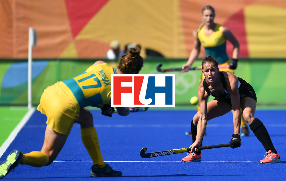 Australia's Georgina Morgan (L) shoots in front of New Zealand's Petrea Webster (R) during the the women's quarterfinal field hockey New Zealand vs Australia match of the Rio 2016 Olympics Games at the Olympic Hockey Centre in Rio de Janeiro on August 15, 2016. / AFP / Pascal GUYOT        (Photo credit should read PASCAL GUYOT/AFP/Getty Images)