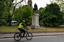 Glasgow, Scotland, UK. 12 June 2020. Black lives matter protestors have vandalised a statue of Prince William of Orange resulting in a police 24 hour presence to deter further graffiti being applied.  Iain Masterton/Alamy Live News