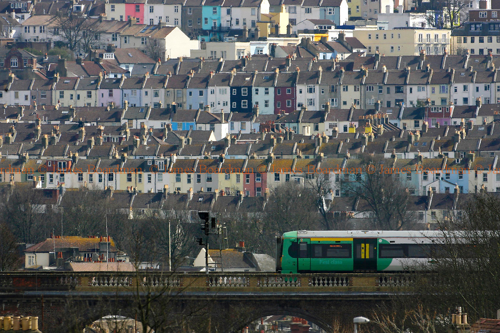 JAMES BOARDMAN / 07967642437<br /> House prices fell by 2.5% in March, the biggest monthly decline since September 1992, much more than many analysts had forecast, the Halifax has said. <br /> A Southern South Central Electrostar train crosses the old London Road viaduct in Brighton, East Sussex.