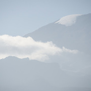 Snow and clouds cover the peak of Mt Kilimanjaro.