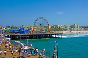 Pacific Park, Santa Monica, CA, Pier, Boardwalk, Ferris Wheel, Roller Coaster, Amusements, Holiday, Walking, playing, Swimming, Beach, water, sand, California, USA,