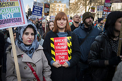 © Licensed to London News Pictures. 04/02/2017. London, UK. Protestors gather outside Downing Street in a demonstration against U.S President Donald Trump's Executive Order banning refugees and immigrants from a number of Muslim-majority countries. Protestors join campaign groups including Stop the War, Stand up to Racism, Muslim Association of Britain, in a march from the U.S Embassy in London to Downing Street. Photo credit: Peter Macdiarmid/LNP