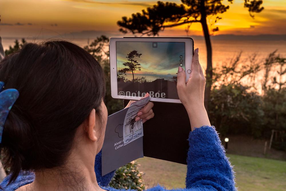 photographing sunset with mounth Fuji near Kamkura Hayama Japan