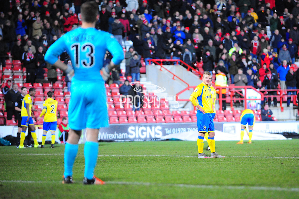 Harry White of Kidderminster Harriers (on loan from Barnsley) reflects on Wrexham's second goal during the Vanarama National League match between Wrexham AFC and Kidderminster Harriers at the Glyndŵr University Racecourse Stadium, Wrexham, United Kingdom on 23 February 2016. Photo by Mike Sheridan.