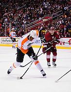 Dec. 3 2011; Glendale, AZ, USA; Philadelphia Flyers forward Wayne Simmonds  (17) takes a shot against the Phoenix Coyotes during the second period at Jobing.com Arena. Mandatory Credit: Jennifer Stewart-US PRESSWIRE.