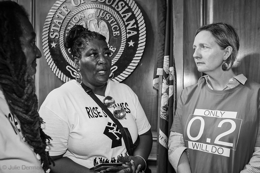 "Members of the Coalition Against Death Alley in the State Capitol  on the last day of a five day march through Louisiana's 'Cancer Alley' in  the reception area of the  Governor's office to deliver a letter. The Coalition Against Death Alley (CADA), is a group of Louisiana-based residents and members of various local and state organizations, is calling for a stop to the construction of new petrochemical plants and the passing of stricter regulations on existing industry in the area that include the groups RISE St. James, Justice and Beyond, the Louisiana Bucket Brigade, 350 New Orleans, and the Concerned Citizens of St. John.  Louisiana's Cancer Alley, an 80-mile stretch along the Mississippi River, is also known as the ""Petrochemical Corridor,"" where there are over 100 petrochemical plants and refineries."