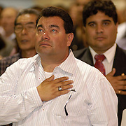 POMONA, CALIFORNIA  8/18/04--Originally from Mexico, a man places his hand over his heart as tears well up in his eyes during the singing of the national anthem at a citizenship ceremony in Pomona, California.<br />                  &copy;  2004  Christopher Morris Immigration along the USA-Mexico border.