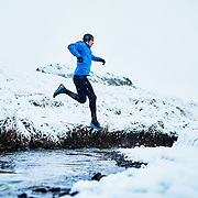 Jordan trail running Akureyri, Iceland in winter.