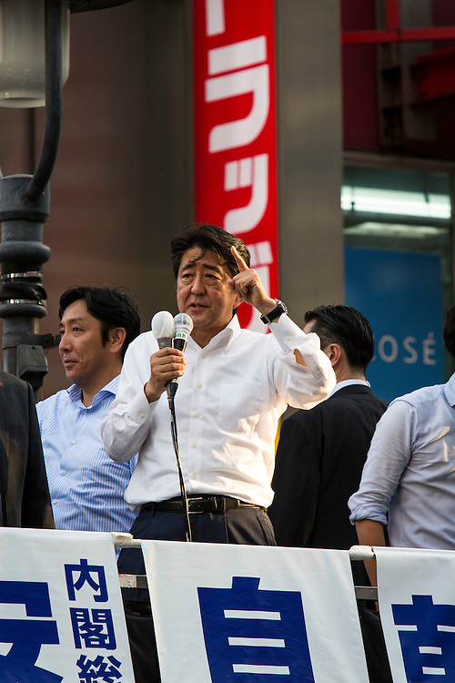 TOKYO, JAPAN - JULY 03 : Japanese Prime Minister Shinzo Abe, president of the ruling Liberal Democratic Party (LDP), delivers a campaign speech for his party candidate Kentaro Asahi during the Upper House election campaign in Shibuya crossing, Tokyo prefecture, Japan, on July 3, 2016. (Photo by Richard Atrero de Guzman/ANADOLU AGENCY)