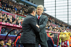 Arsenal Manager Arsene Wenger and Aston Villa Manager Remi Garde greet each other before the game - Mandatory byline: Dougie Allward/JMP - 13/12/2015 - Football - Villa Park - Birmingham, England - Aston Villa v Arsenal - Barclays Premier League