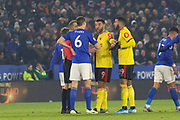 Troy Deeney (9) & Etienne Capoue (29) with Jonny Evans (6)during the Premier League match between Leicester City and Watford at the King Power Stadium, Leicester, England on 4 December 2019.