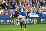 Sheffield Wednesday defender Jack Hunt (2)   and Sheffield United defender Enda Stevens (3) challenge for the ball during the EFL Sky Bet Championship match between Sheffield Wednesday and Sheffield Utd at Hillsborough, Sheffield, England on 24 September 2017. Photo by Adam Rivers.
