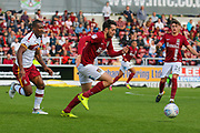 Northampton Town defender Brendan Moloney wins the ball ahead of Bradford City forward Dominic Poleon during the EFL Sky Bet League 1 match between Northampton Town and Bradford City at Sixfields Stadium, Northampton, England on 23 September 2017. Photo by Aaron  Lupton.