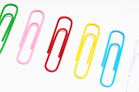 Row of multi colored paper clips