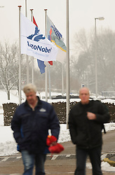 AkzoNobel employees walk past banners bearing the AkzoNobel logo work at the AkzoNobel paint production facility in Sassenheim, the Netherlands, Wednesday, Dec. 22, 2010. Akzo Nobel NV, the world's biggest paint maker, reported a 21 percent increase in third quarter net income to 238 million euros. (Photo © Jock Fistick)