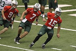 June 12, 2012; Florham Park, NJ, USA; New York Jets quarterback Tim Tebow (15) and New York Jets quarterback G.J. Kinne (7) during New York Jets Minicamp at the Atlantic Health Training Center.