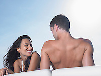 Young couple relaxing on cushions outdoors