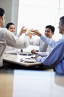 Business associates toasting with wine glasses