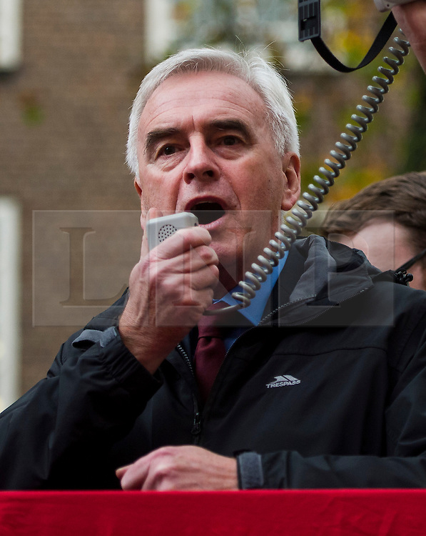 © Licensed to London News Pictures. 04/11/2015. London, UK.   JOHN MCDONNELL speaking as Thousands of students take part in a demonstration in central London against tuition fees. The rally which starts outside the University of London Union, will feature a speech from Shadow Chancellor John McDonnell.  Photo credit: Ben Cawthra/LNP