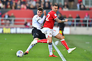 Mason Mount (8) of Derby County is challenged by Jack Hunt (32) of Bristol City during the EFL Sky Bet Championship match between Bristol City and Derby County at Ashton Gate, Bristol, England on 27 April 2019.