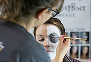 Kristen Fechtel, left, a senior studying scenic painting, puts Day of the Dead makeup on Abby Barnett, a junior at Vinton County High School, at the Student Expo on April 14, 2016. Photo by Emily Matthews