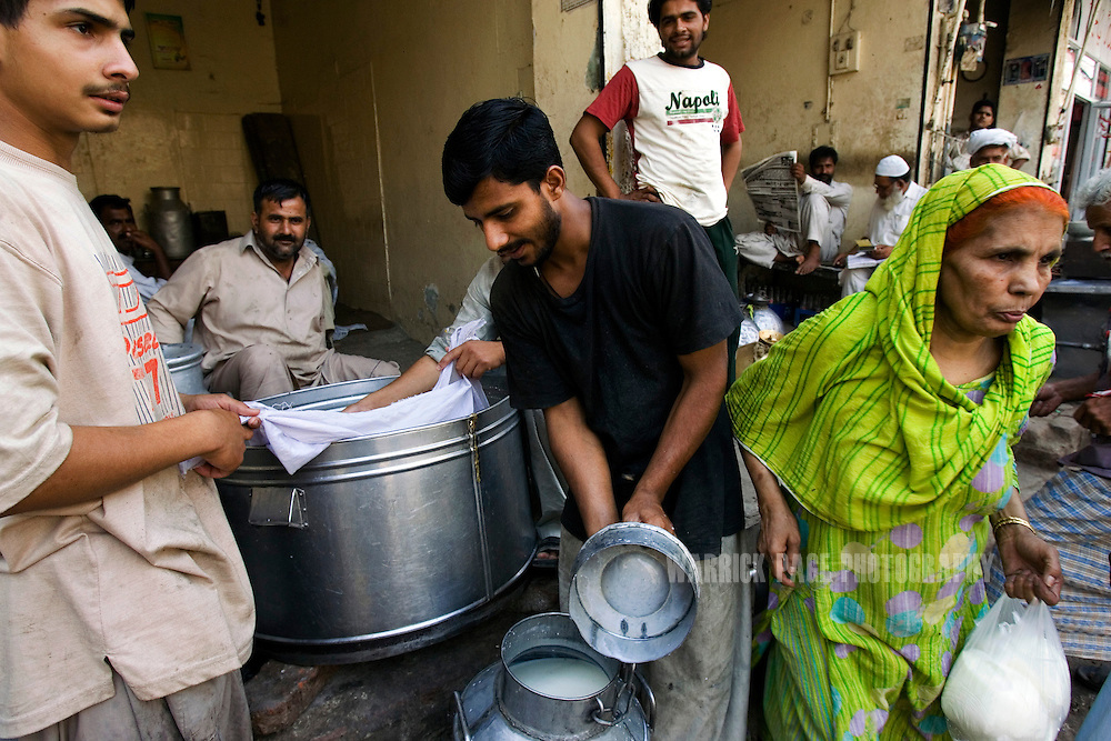LAHORE, PAKISTAN - MAY 7: Locals purchase milk from vendors at a market on May 7, 2007, in Lahore, Pakistan.  (Photo by Warrick Page)